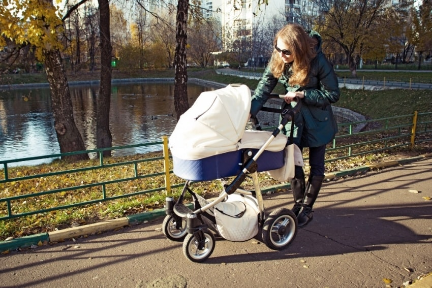 mother and baby stroller in a park