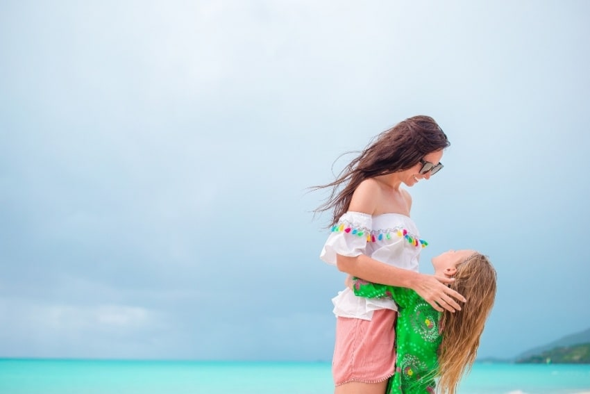 mother and daughter somewhere in the caribbean