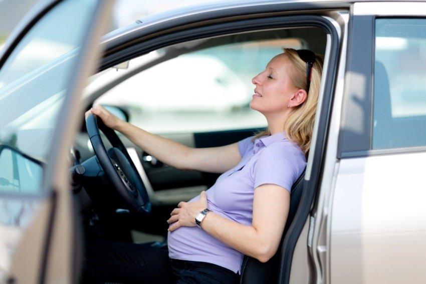 tired woman a car