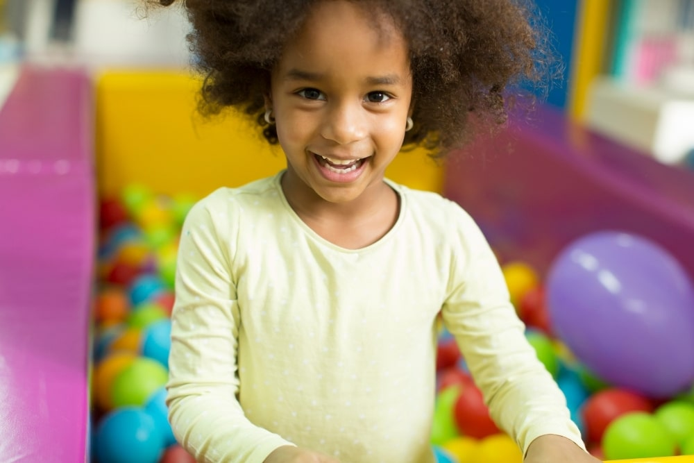 african girl in a play house