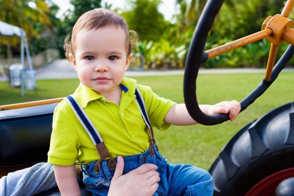 baby boy sitting in a car