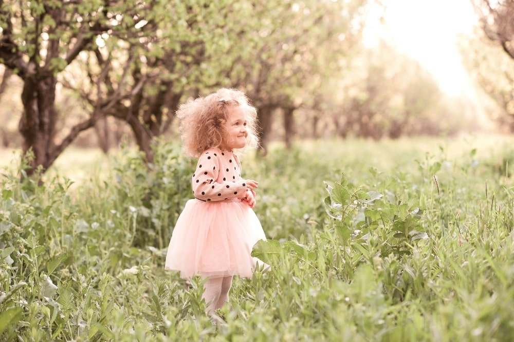 baby girl in a pink dress outdoor