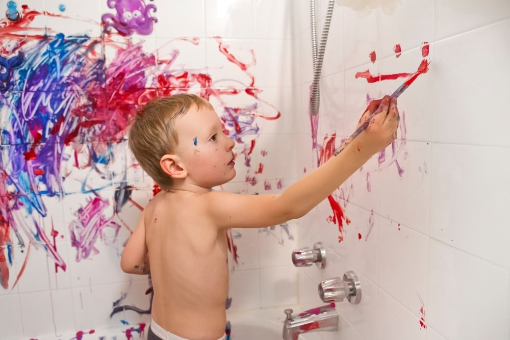 boy drawing on the wall