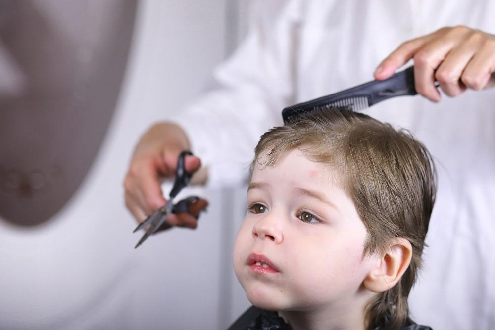 boy having a hair cut