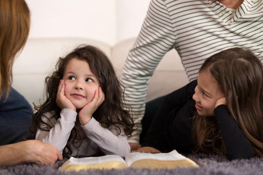 children listening to adult talk