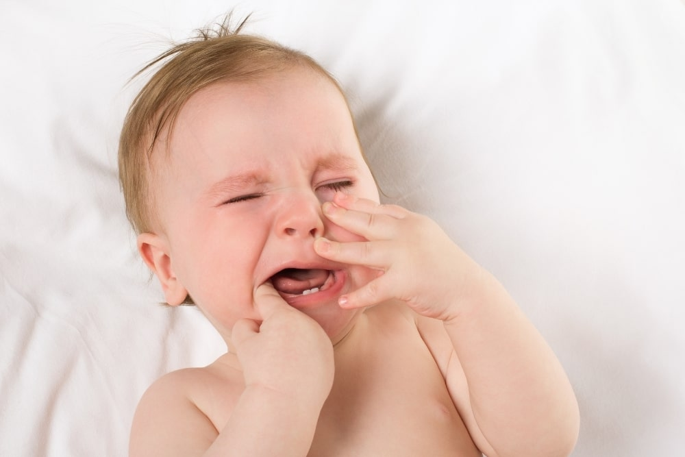 8 Tips To Soothe A Teething Baby At Night