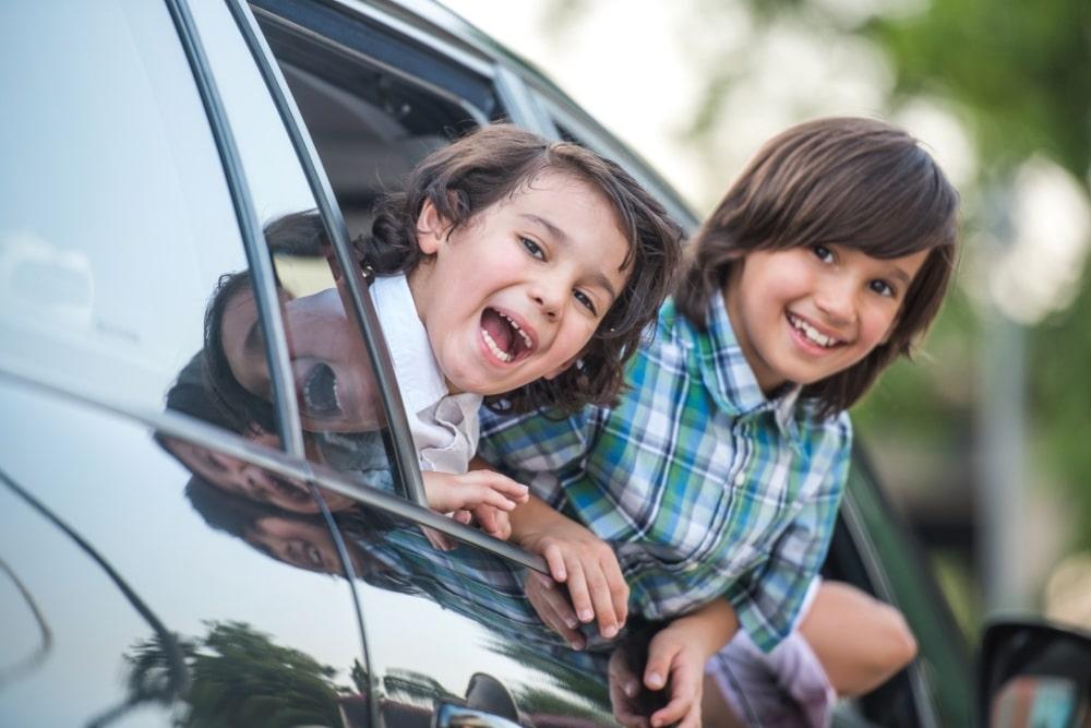 kids riding a car