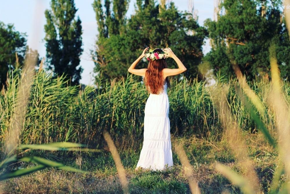 woman outdoors wearing a white dress