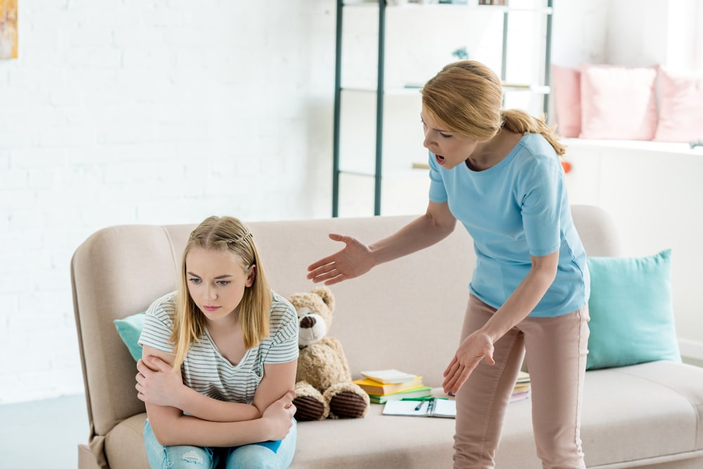 Angry mother yelling at teen daughter at home