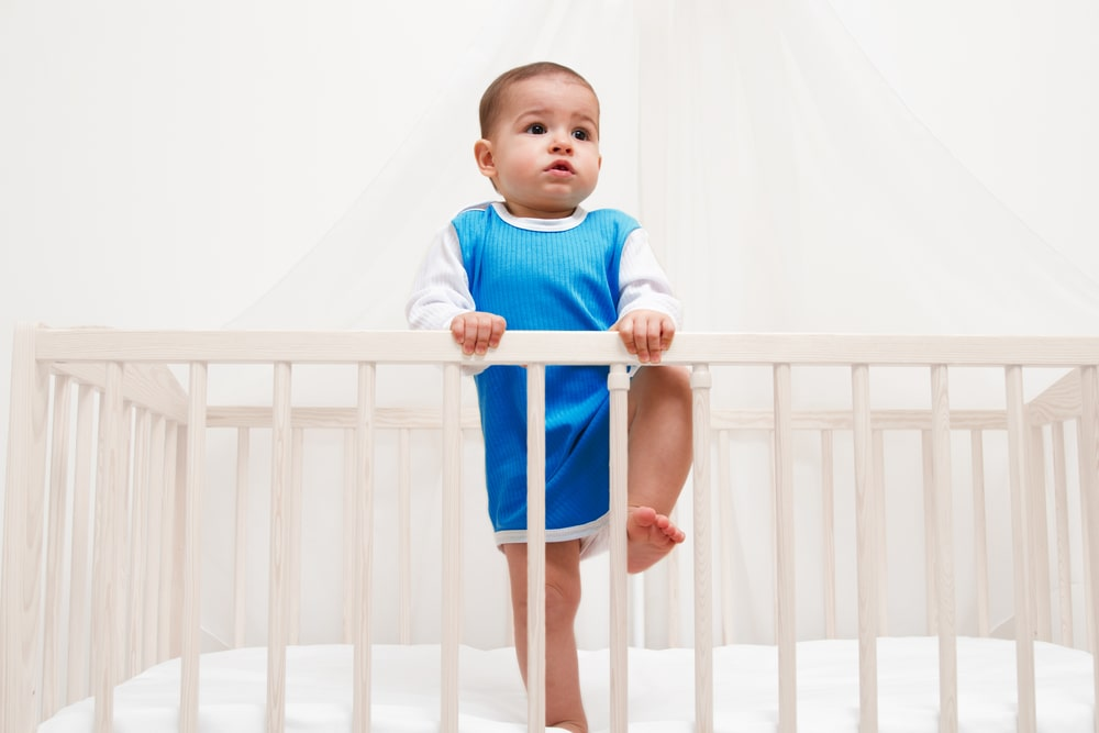 Baby climbs out of the crib