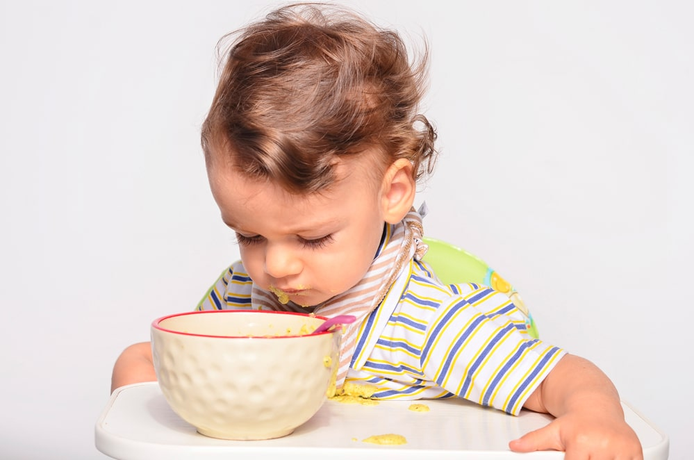 Why Your Toddler Is Spitting Out Food and What To Do About It