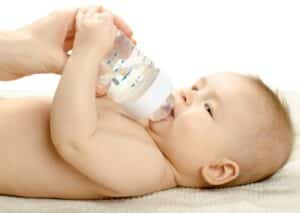 Baby holding a milk bottle