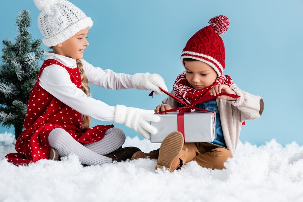 Children in hats and winter outfit
