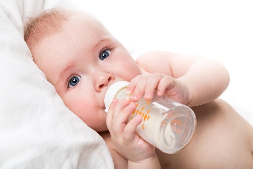 Cute baby boy with milk