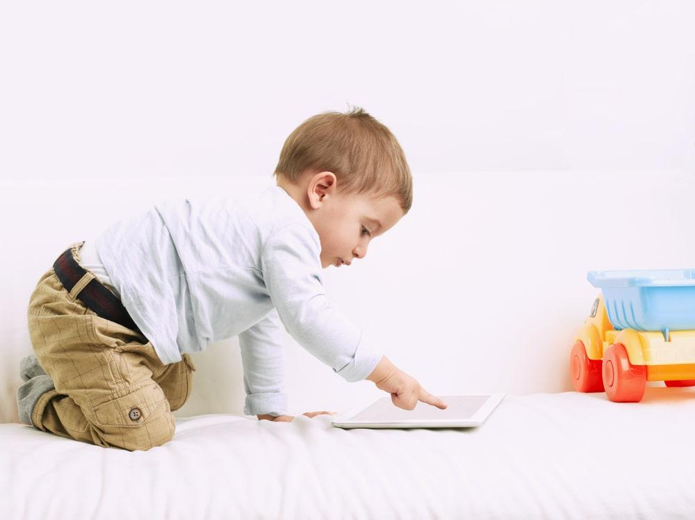 Cute little boy reading book in room1