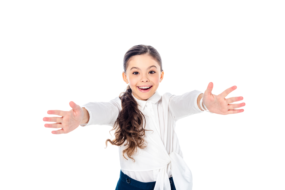 Happy schoolgirl in formal wear with outstretched hands