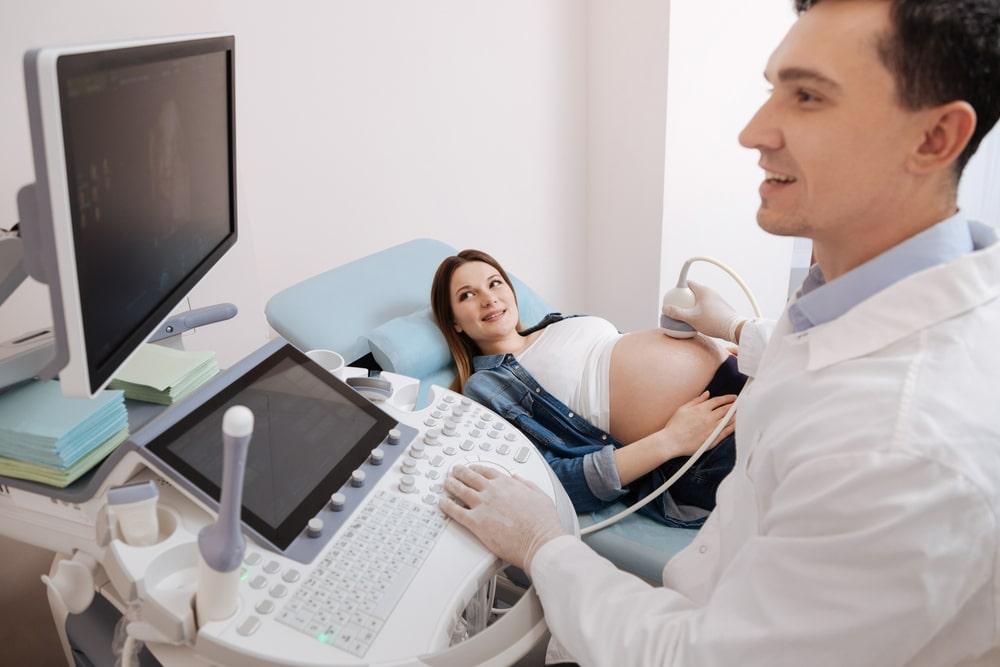 Smiling practitioner providing checkup