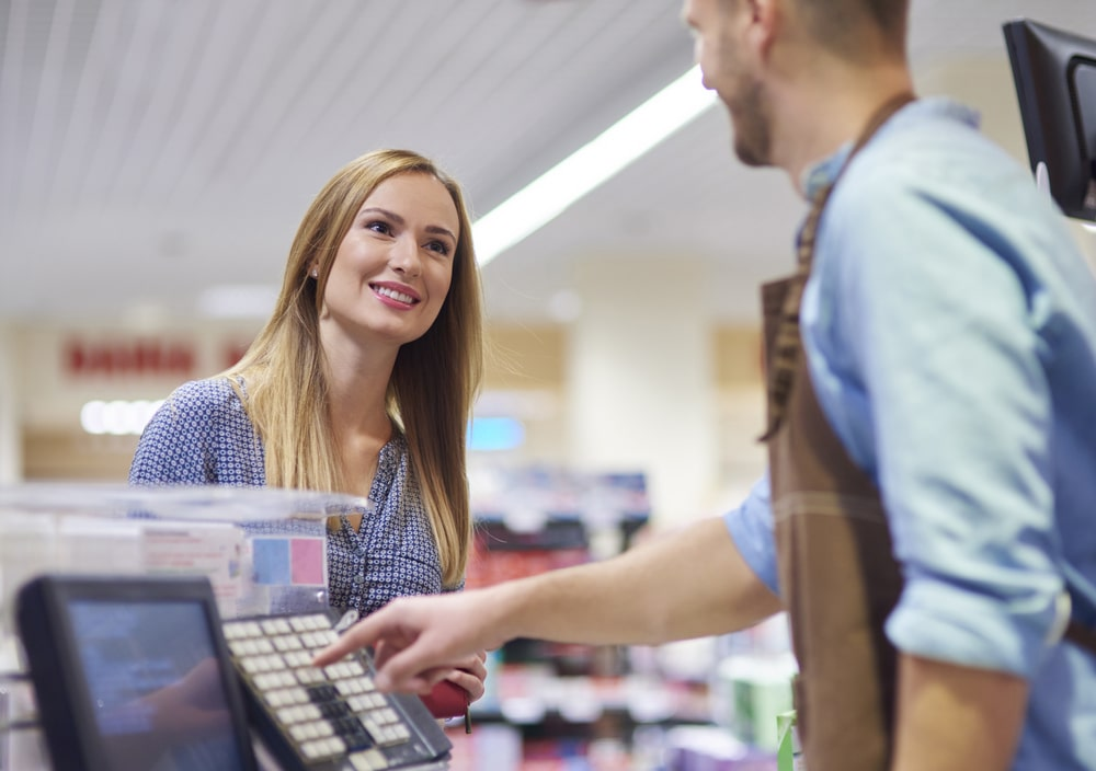 Woman next to cash register