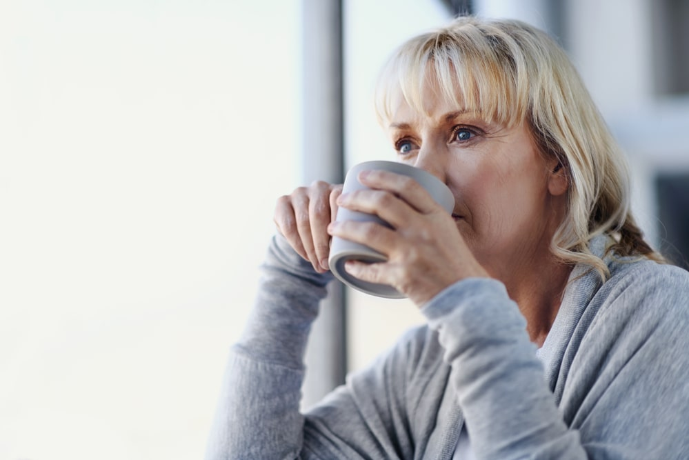 Blonde woman sipping a cup of tea