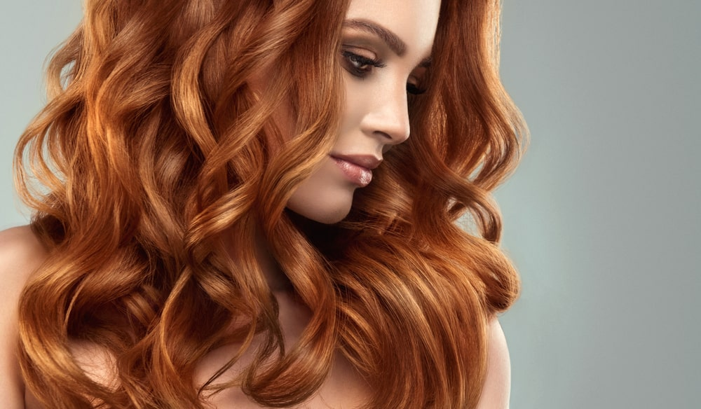 Model girl with long red curly hair