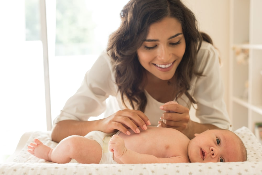 Mother moisturizing baby1