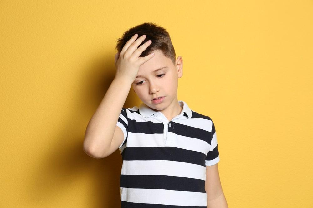 Portrait of emotional preteen boy