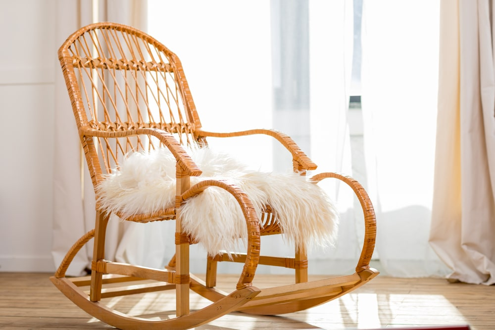 Rocking chair with woolly rug