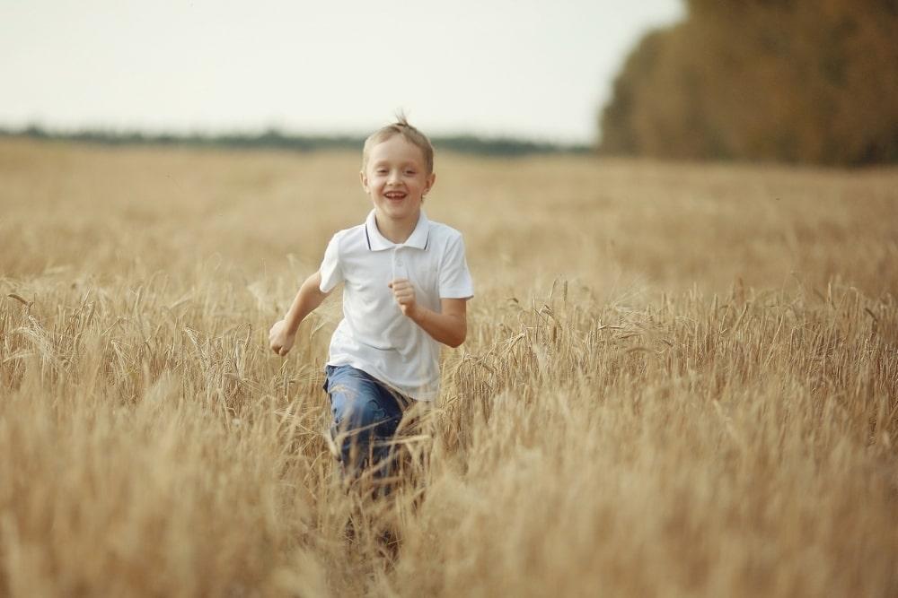 boy running across a field