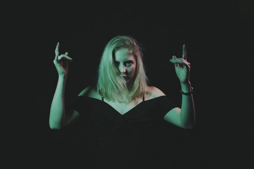 woman in dark background