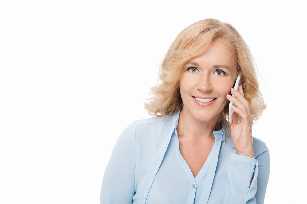Mature woman talking by phone