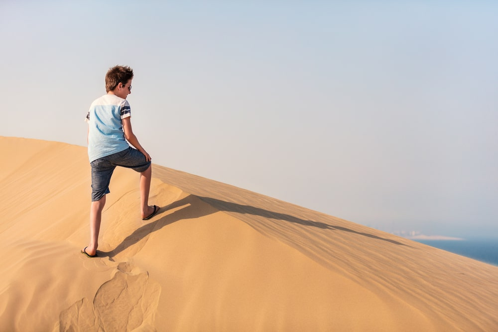 Teenage boy having fun at desert