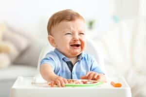 Is Your Baby Crying While Eating Solids? Reasons and Tips To Help